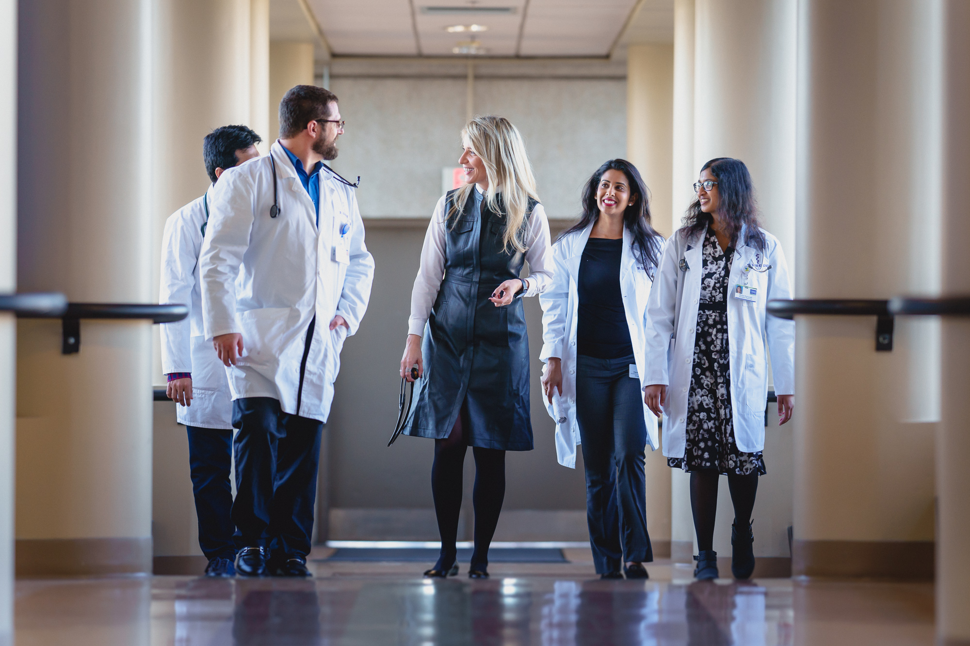 Internal medicine faculty member walking with residents