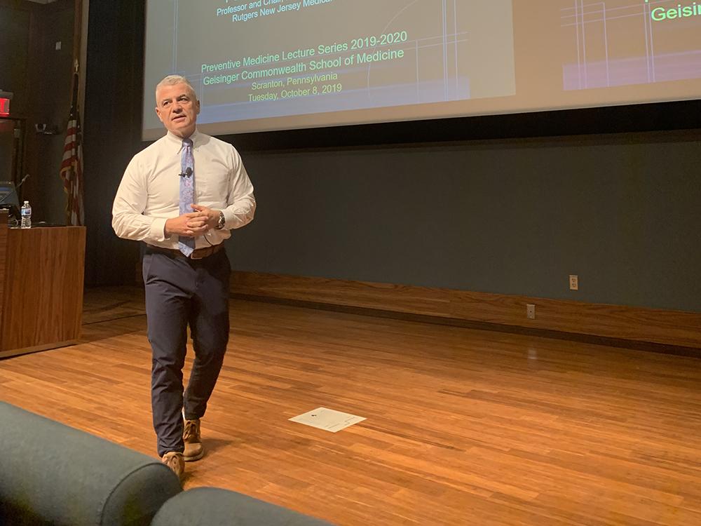 Man presenting a preventive medicine conference